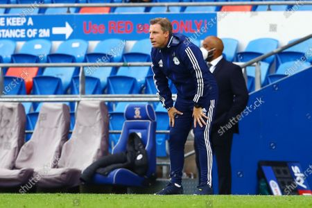 Cardiff City Manager Neil Harris watches on.