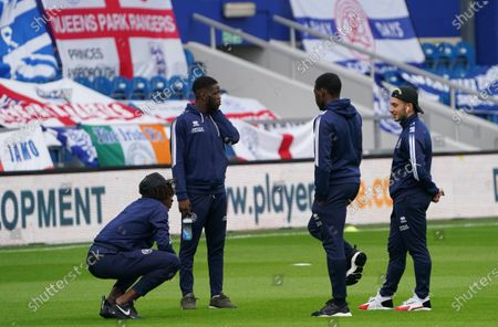 Eberechi Eze, Bright Osayi-Samuel and Ilias Chair of QPR  on the pitch before the match