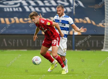 Tom Cairney of Fulham and Dominic Ball of QPR