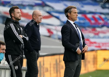 Fulham Manager Scott Parker stands in front of Mark Warburton - Manager of QPR