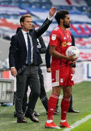 Fulham Manager Scott Parker behind winning goalscorer Cyrus Christie of Fulham