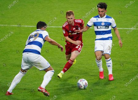 Harrison Reed of Fulham inbetween Ilias Chair and Yoann Barbet of QPR