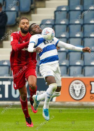 Bright Osayi-Samuel of QPR ahead of Michael Hector of Fulham