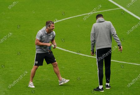 Joe Bryan and Jordan Archer of Fulham on the pitch before the match