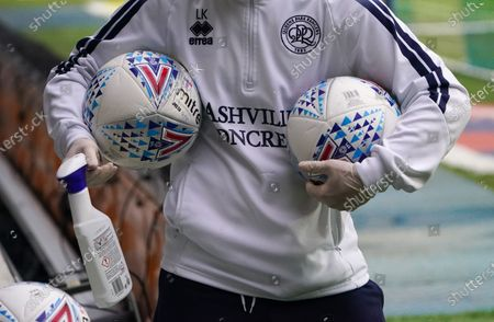 Footballs, cleaned with a bottle of Flash at the side of the pitch