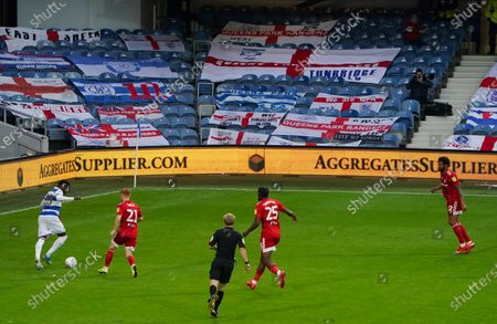 Flags displayed on the seats, behind the action inside Loftus Road, a behind closed doors match between QPR and Fulham