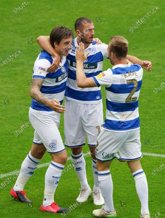 Jordan Hugill of QPR celebrates scoring the opening goal from a header, with Todd Kane and Dominic Ball
