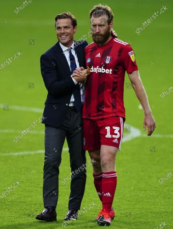 A smiling Fulham Manager Scott Parker with Tim Ream at full time