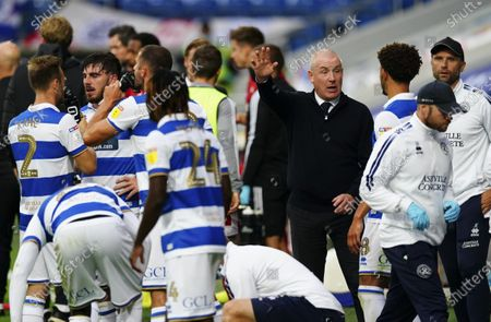 Mark Warburton - Manager of QPR with his players during the drinks break