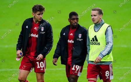 L-r Tom Cairney, Ivan Cavaleiro and Stefan Johansen of Fulham walk off at full time