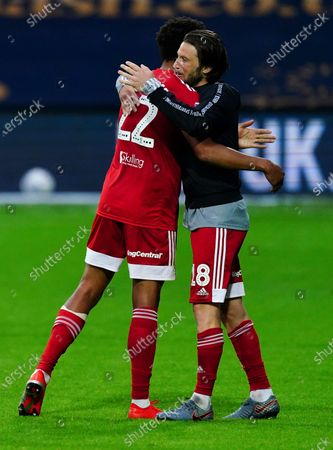 Winning scorer Cyrus Christie of Fulham hugs fellow scorer Harry Arter at full time