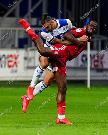 Josh Onomah of Fulham battles with Geoff Cameron of QPR