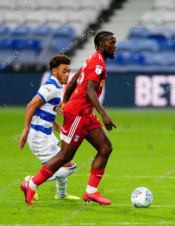 Josh Onomah of Fulham chased by Luke Amos of QPR