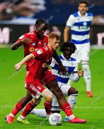 Josh Onomah and Harrison Reed of Fulham combine to thwart Eberechi Eze of QPR