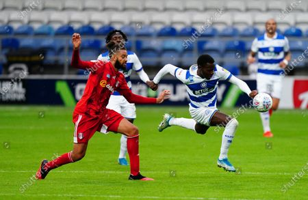 Bright Osayi-Samuel of QPR gets away from Michael Hector of Fulham