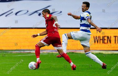 Anthony Knockaert of Fulham pressured by Yoann Barbet of QPR