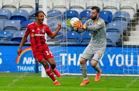 QPR Goalkeeper Liam Kelly catches under pressure from Bobby De Cordova Reid of Fulham