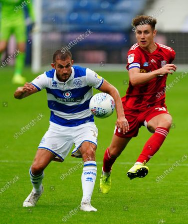Dominic Ball of QPR under pressure from Tom Cairney of Fulham