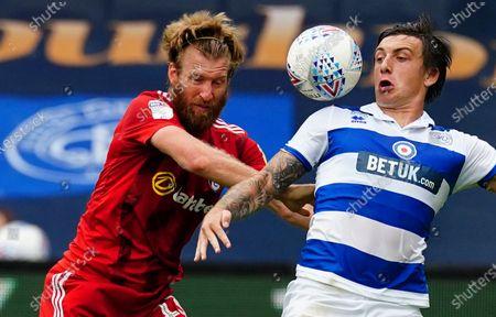 Tim Ream of Fulham battles with Jordan Hugill of QPR