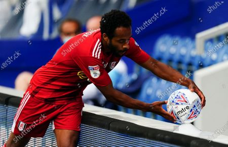 Denis Odoi of Fulham picks up a disinfected ball