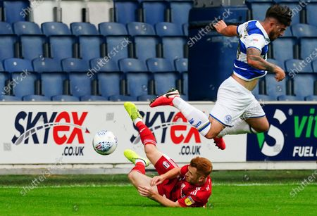 Ryan Manning of QPR hurdles the challenge from Harrison Reed of Fulham