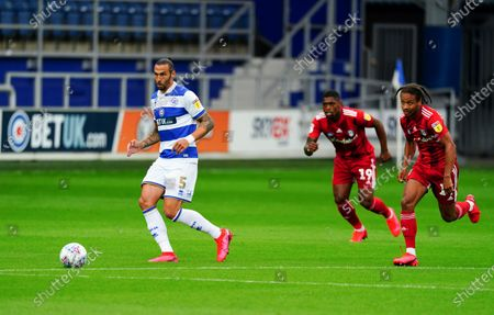 Geoff Cameron of QPR chased by Ivan Cavaleiro, centre, and Bobby De Cordova Reid of Fulham
