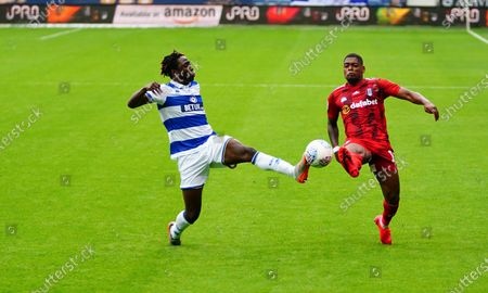 Osman Kakay of QPR battles with Ivan Cavaleiro of Fulham