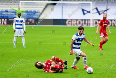 Harry Arter of Fulham shouts after a tackle from Ryan Manning of QPR