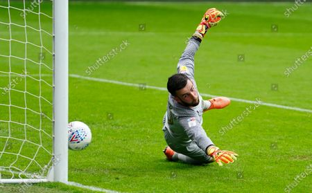 QPR Goalkeeper Liam Kelly is beaten but the shot from Harrison Reed of Fulham hits the post