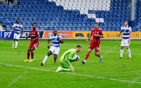 Goalkeeper Marek Rodak of Fulham drops on the ball ahead of Olamide Shodipo of QPR late on