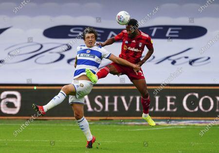 Denis Odoi of Fulham battles with Jordan Hugill of QPR
