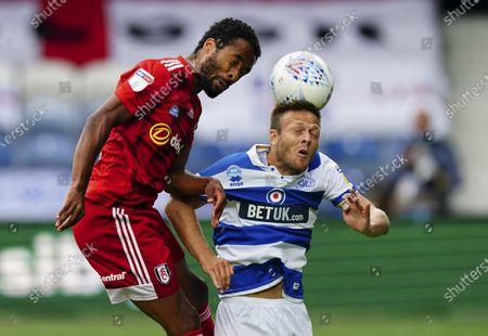 Denis Odoi of Fulham battles with Todd Kane of QPR