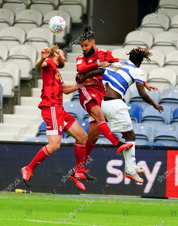 Tim Ream and Michael Hector of Fulham combine to deny Osman Kakay of QPR