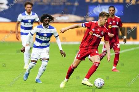 Tom Cairney of Fulham spins away from Eberechi Eze of QPR