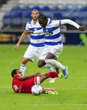 Bright Osayi-Samuel of QPR hurdles over the tackle from Denis Odoi of Fulham