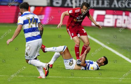 Harry Arter of Fulham appears to catch Yoann Barbet of QPR  in the stomach