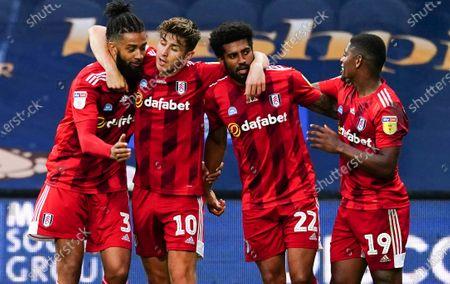 Cyrus Christie of Fulham celebrates scoring a goal 2-1