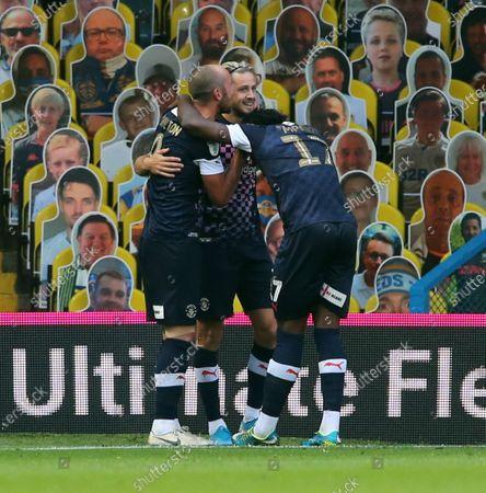 Harry Cornick celebrates scoring Lutons first goal with temmates
