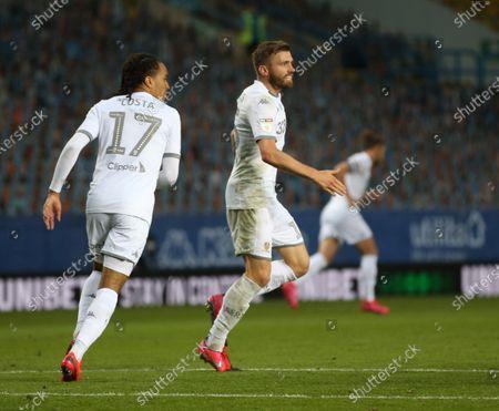 Stuart Dallas celebrates scoring Leeds first goal