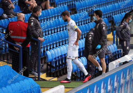 Liam Cooper of Leeds United leaves the game through injury