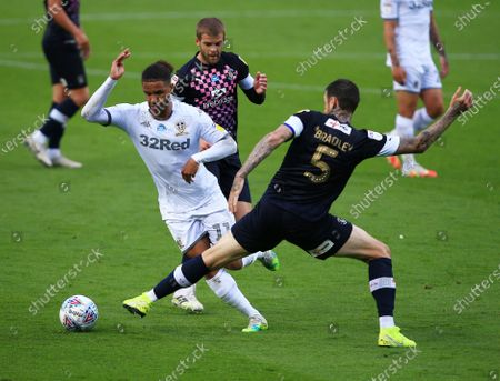 Tyler Roberts of Leeds United and Sonny Bradley of Luton Town
