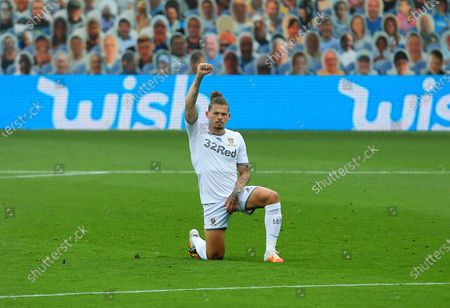 Kalvin Phillips of Leeds United takes a knee ahead of the game