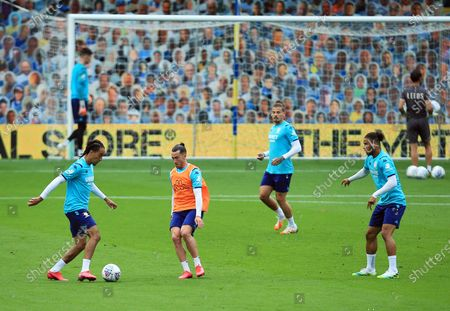 Leeds United players warm up ahead of the game