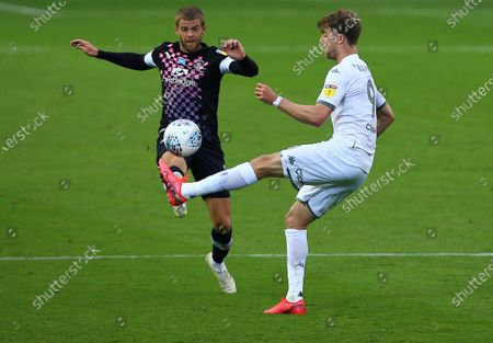 Patrick Bamford of Leeds United and Martin Cranie of Luton Town