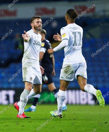 Stuart Dallas of Leeds United celebrates celebrates scoring a goal to make it 1-1 with Tyler Roberts
