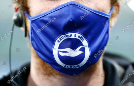 A face mask with the Brighton and Hove Albion badge on.
