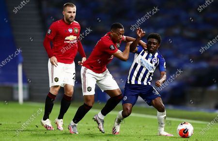 Anthony Martial of Manchester United and Tariq Lamptey of Brighton & Hove Albion.