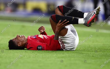 Marcus Rashford of Manchester United appears in pain after being fouled.