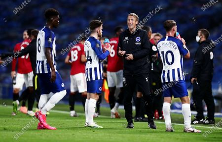 Brighton & Hove Albion Manager Graham Potter speaks with his players during a drinks break.