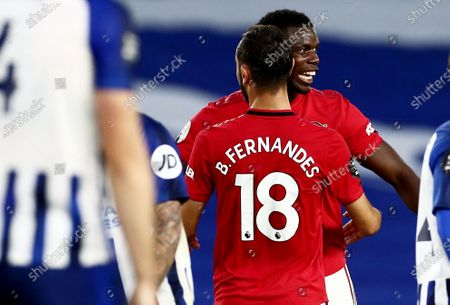 Bruno Fernandes of Manchester United celebrates scoring his sides second goal with team mate Paul Pogba.